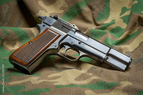 Fényképezés Belgian made Browning Hi-Power 9mm semiautomatic handgun with wood checkered gri