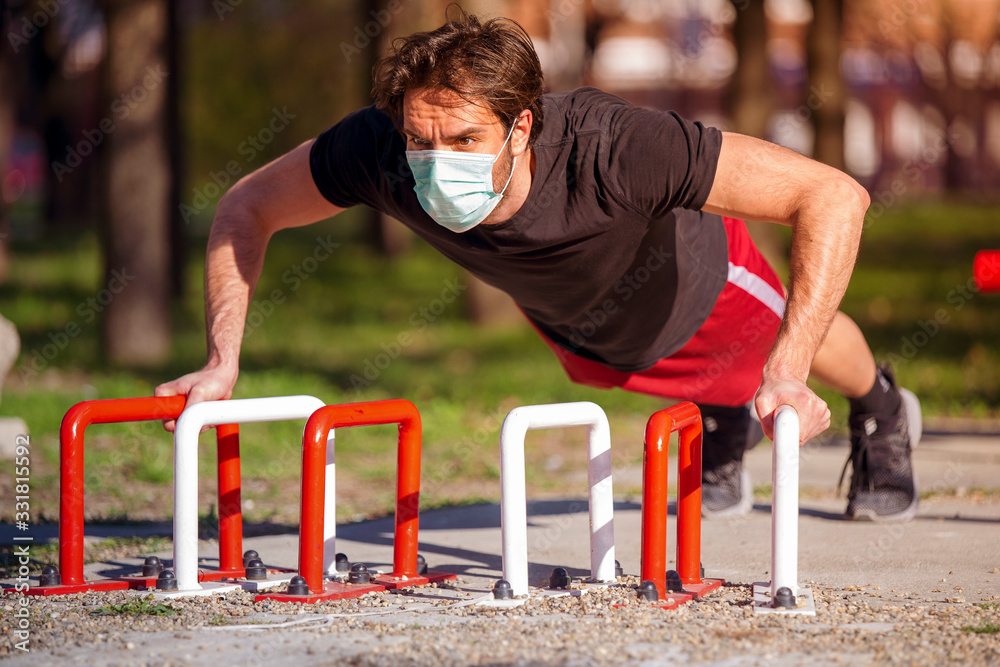 Fototapeta Single male on the training, street workout, with mask preventive of corona virus