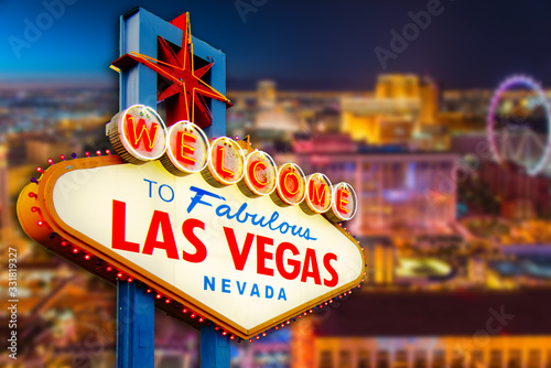 Fotografie, Tablou Welcome to Never Sleep city Las Vegas, Nevada Sign with the heart of Las Vegas scene in blur background