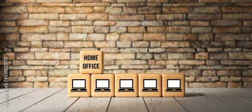 cubes with computer symbols and text HOME OFFICE in front of a brick wall
