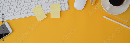 Cropped shot of computer device on yellow background