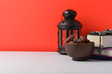 Lantern, Dates Fruit And Rosary On Red Background. Islamic Holidays Concept.