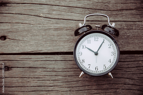Cuadros en Lienzo old clock place on wooden background with space for text for times memory concept