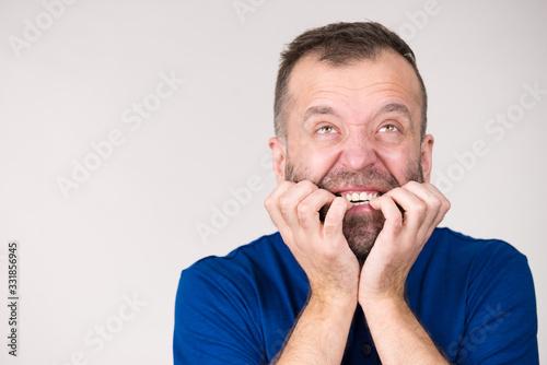 Man biting his nails Wallpaper Mural