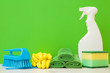 canvas print picture - Cleaning set for different surfaces in kitchen, bathroom and other rooms. Empty place for text or logo. Bright green background. Spring regular cleanup. Front view. Closeup.