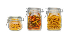 Pasta In Three Glass Jars Isolated On A White Background.