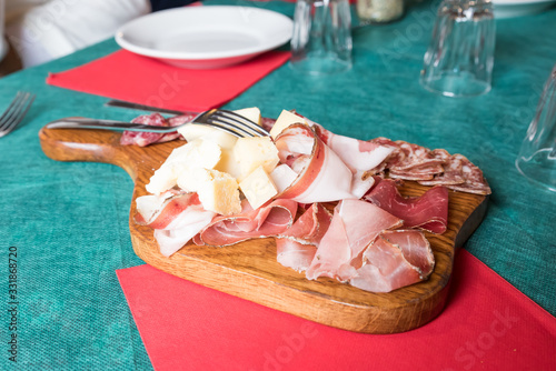 Fototapeta Selection of cold cuts and cheeses from Trentino obraz