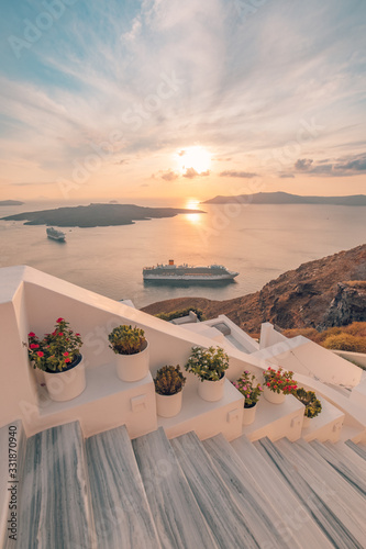 Fototapeta Fira town, with view of caldera, volcano and cruise ships, Santorini, Greece. Cloudy dramatic sky. obraz