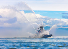 Floating Tug Boat Is Spraying Jets Of Water