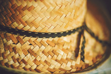An Old Farmer's Straw Hat With...