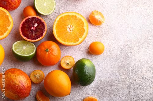 Fotografiet natural organic citrus fruit on a wooden plate