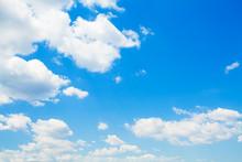 Fluffy Clouds In Blue Sky. Bac...