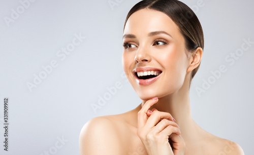 Leinwand Poster Beautiful young woman with clean fresh skin on face