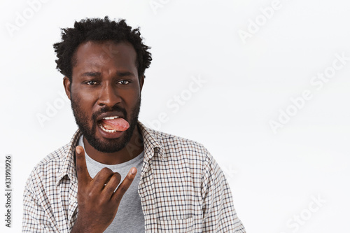 Sassy and cool handsome african-american bearded confident guy, acting all cheek Canvas Print