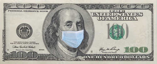 Fototapeta Benjamin Franklin in a mask on a 100 dollar bill isolated on white background. Concept of prevention of money from crisis. obraz
