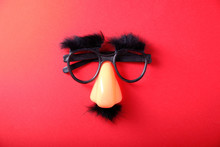 Overhead Glasses, Nose And Mustache For April 1, April Fool's Day, On Red Background