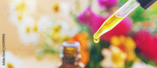 Photo Homeopathy. Herbal extracts in small bottles. Selective focus.