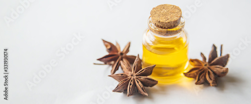 Photo Star anise oil in a small bottle. Selective focus.