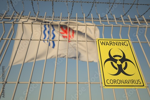 Photo Coronavirus warning sign on the barbed wire fence near flag with coat of arms of Nouvelle-Aquitaine, a region of France