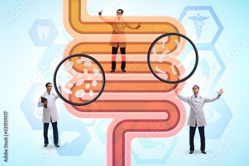 Fotografia Doctors treating intestines illness - medical illustration