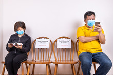 People With Face Mask Seated I...