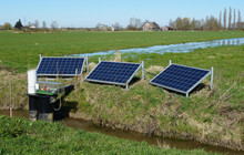Solar Powered Water Pump In A Rural Polder Landscape In The Netherlands