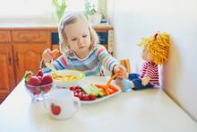 Adorable Toddler Girl Eating F...