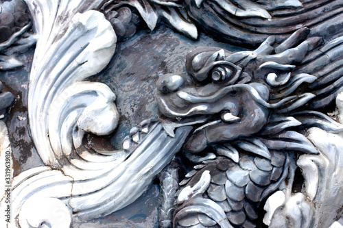 Bas-relief in the form of dragons adorning a temple Wallpaper Mural
