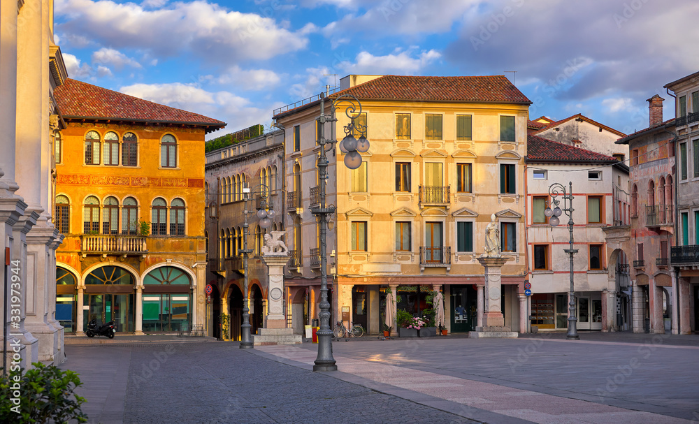 Bassano del grappa Italy. Square freedom. Landscape old town with italian architecture and street lamp. Sunrise at deserted street.