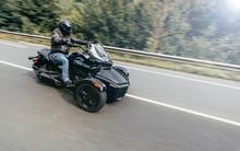 Unknown Motorbiker Riding Three Wheels Motorbike Along Mountain Road