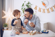 Father And Son Painting Eggs F...