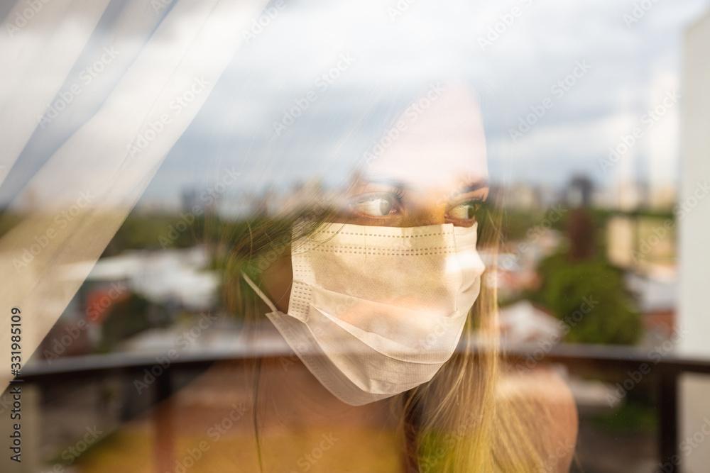 Fototapeta Quarantine girl in her apartment due to the cororavirus epidemic