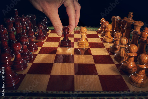Fotografija Handcrafted inlaid chess with pieces carved from olive wood