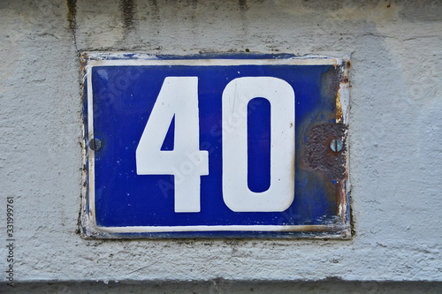 A house number plaque, showing the number fourty (40) Wallpaper Mural