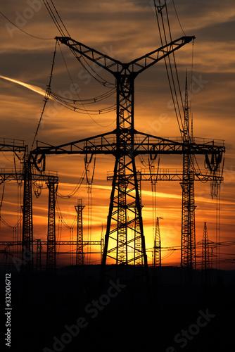 electricity pylons at sunset Wallpaper Mural