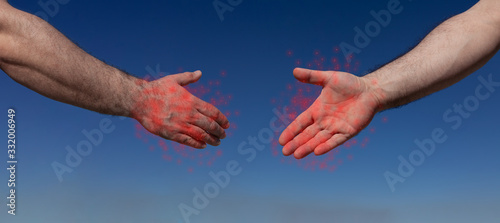 Two male hands on a blue background almost shaking hands, keeping a safe distanc Slika na platnu