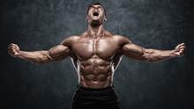 Muscular Man Showing Muscles O...