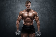Muscular Man With Dumbbells On...