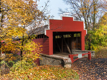 Red Covered Bridge Surrounded ...