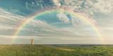 Fototapeta Tęcza - Rainbow over summer wild stepp