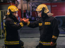 Portrait Of Two Young Firemen ...