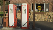Antique Red Gas Pumps In Front...
