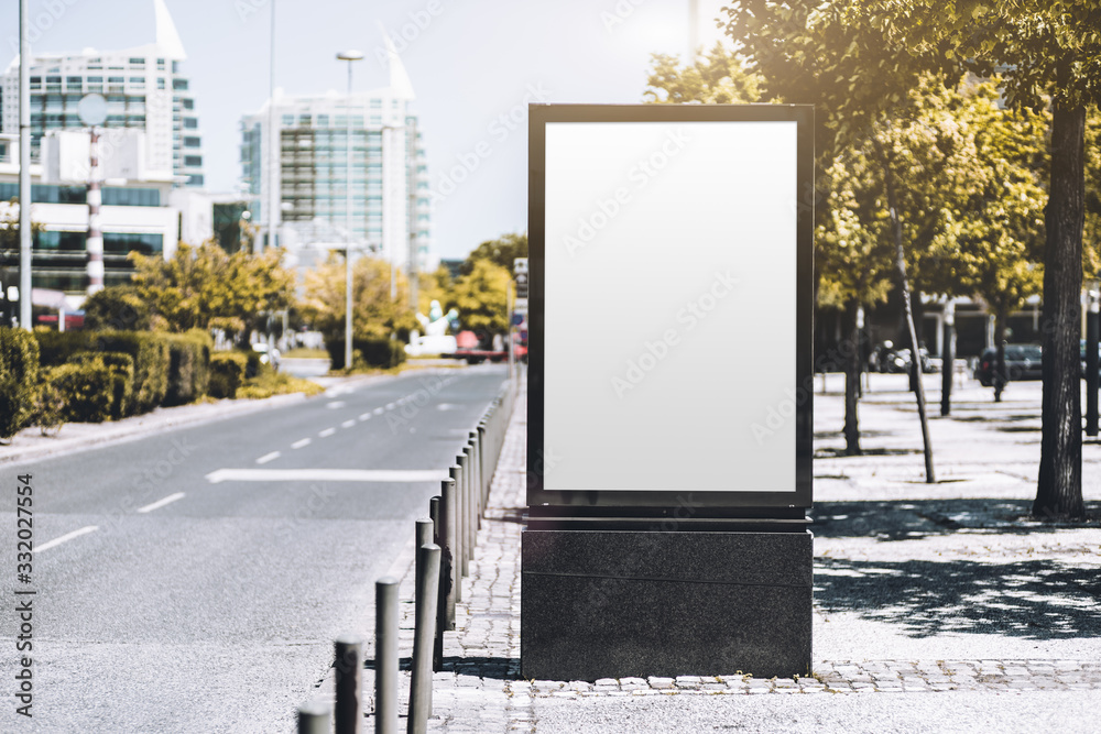 Mockup of an empty information poster in urban settings near a city road; a blank vertical street banner template on the sidewalk in alleyway; an outdoor billboard placeholder mock-up near the highway