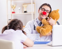Funny Pediatrician With Little...