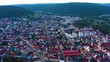 Aerial view of the city Tuttlingen. On a sunny day in summer. Pan to the left across the city.