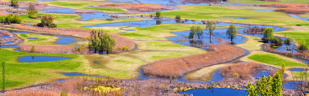 Fototapeta Spring landscape, panorama, banner - flood of the Siverskyi (Seversky) Donets river, the winding river flows through meadows between hills and forests, the northeast of Ukraine