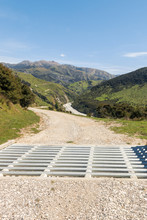 Cattle Grid With Gravel Road A...