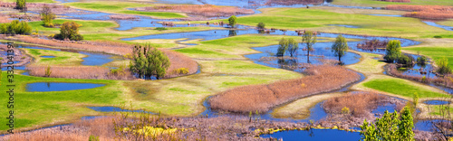 Fototapeta Spring landscape, panorama, banner - flood of the Siverskyi (Seversky) Donets river, the winding river flows through meadows between hills and forests, the northeast of Ukraine obraz