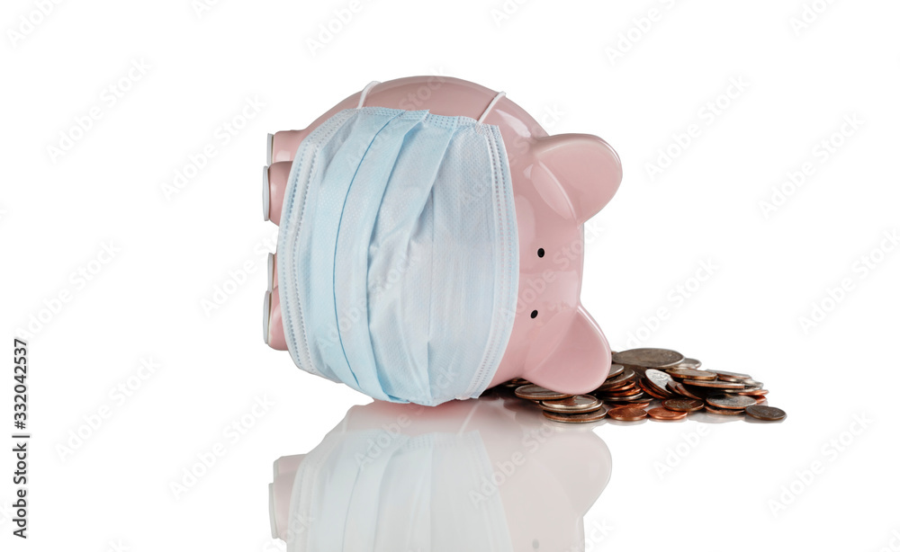 Fototapeta Tipped over piggy bank with medical mask on and coins for financial crisis concept