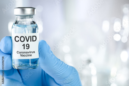 Canvas Print Healthcare cure concept with a hand in blue medical gloves holding Coronavirus,
